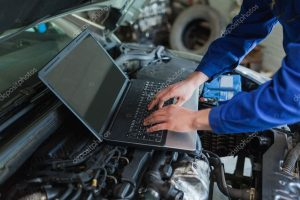 depositphotos_24096043-stock-photo-auto-mechanic-using-laptop